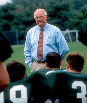 President Wrights talks with the Dartmouth Football team during practice.
