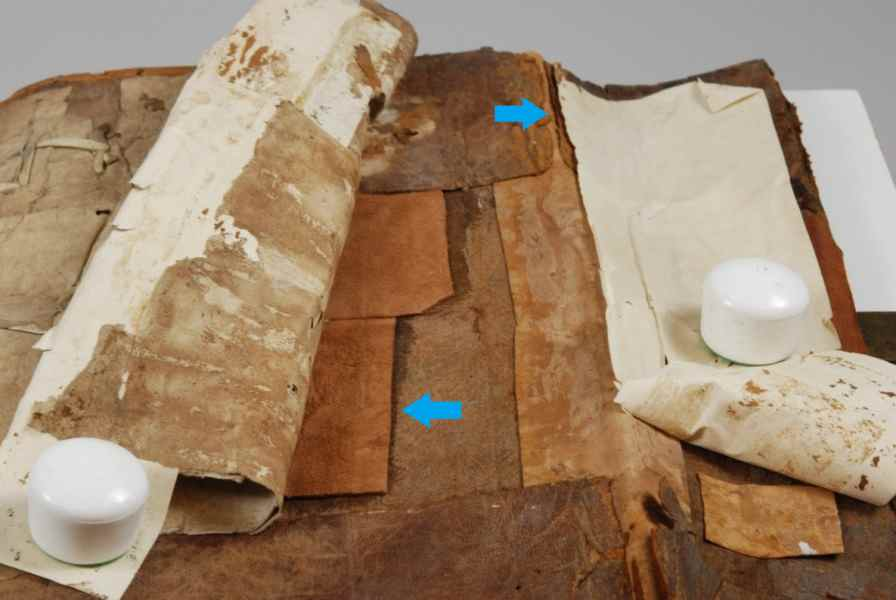 Inside cover, previous modern repair: machine-made paper and leather patches to reinforce the cover. Photo by Deborah Howe, courtesy of Dartmouth College Library.