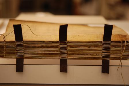 Completed sewing of the text block on leather supports. Photo by Deborah Howe, courtesy of Dartmouth College Library.