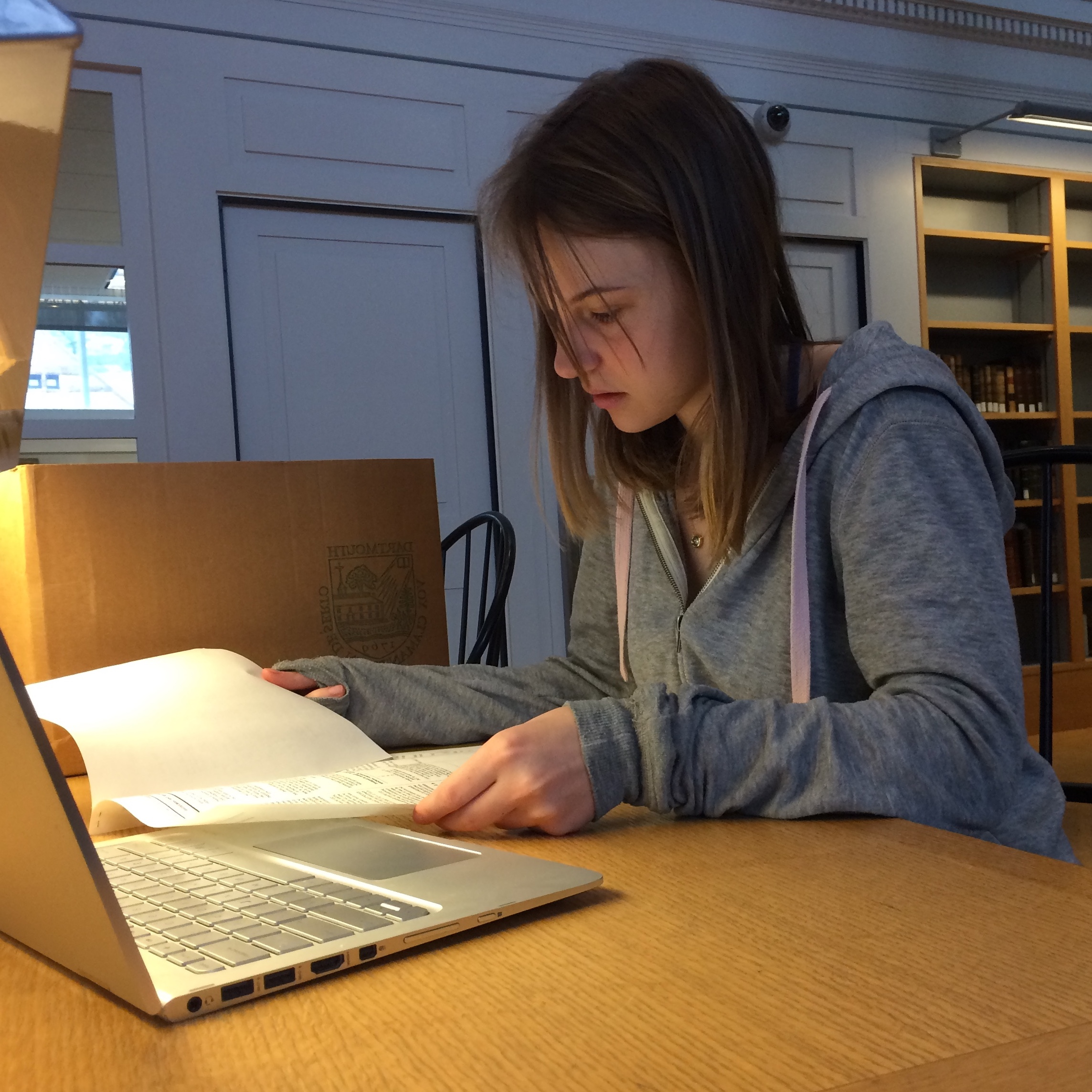 A student research fellow works with primary sources in Rauner Library's reading room